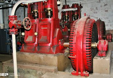 A pair of ancient Carbon Dioxide air conditioning compressors, powered by two antique 150 horsepower open frame synchronous motors