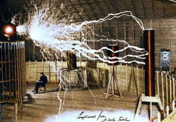 Nikola Tesla in his Colorado Laboratory with magnifying transmitter